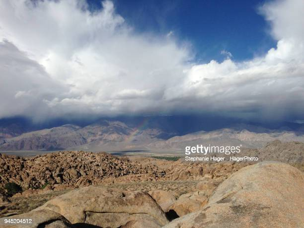 rock formations and clouds - alabama hills stock photos and pictures
