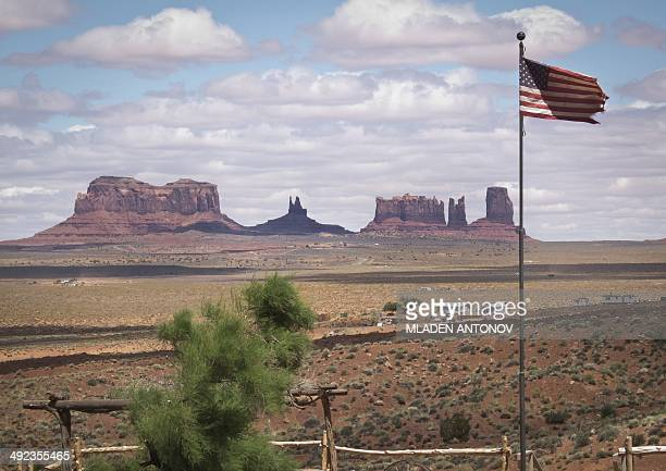 Rock formations are seen behind the American flag at Gouldings Lodge and Trading Post in Monument Valley Navajo Tribal park Utah on May 12 2014...