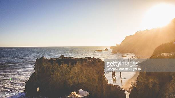 rock formations at el matador beach against sky on sunny day - malibu beach stock pictures, royalty-free photos & images