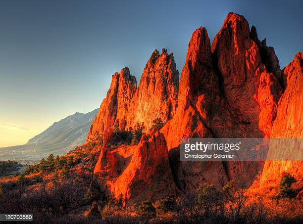rock formations at sunrise - garden of the gods stock photos and pictures
