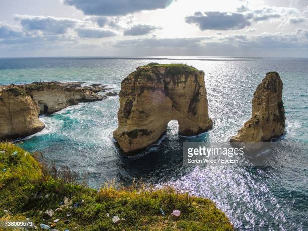 rock formations by sea against sky - lebanon stock pictures, royalty-free photos & images