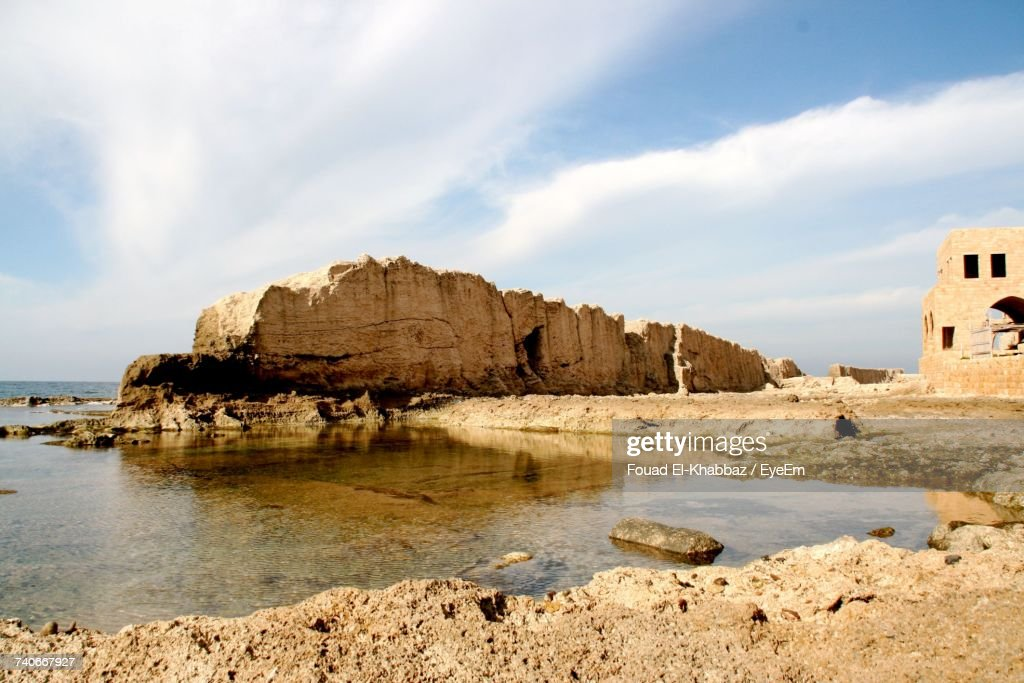 Rock Formations By Sea Against Sky : Stock Photo