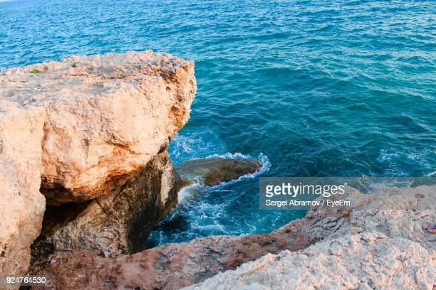 rock formations by sea - sergei stock pictures, royalty-free photos & images