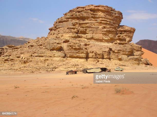 rock formations in a desert, jebel qatar, wadi rum, jordan - qatar desert stock photos and pictures