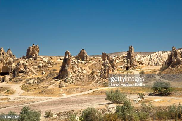 rock formations in a desert - central anatolia stock photos and pictures
