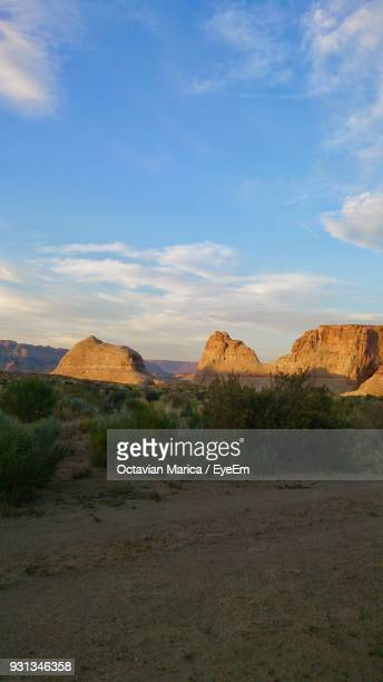 rock formations in a desert - marica octavian stock photos and pictures