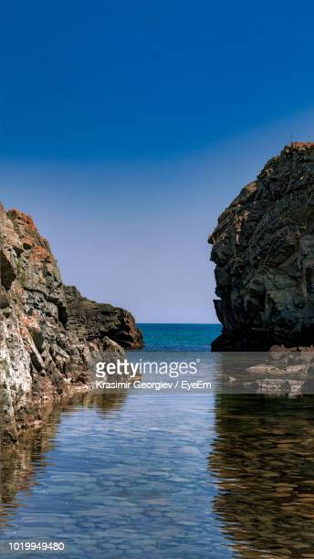 rock formations in sea against clear blue sky - krasimir georgiev stock photos and pictures