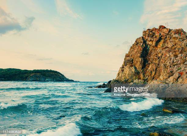 rock formations in sea against sky - krasimir georgiev stock photos and pictures