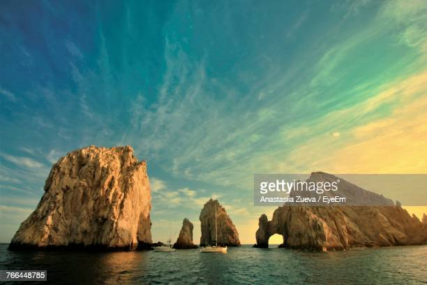 rock formations in sea against sky - cabo san lucas stock pictures, royalty-free photos & images