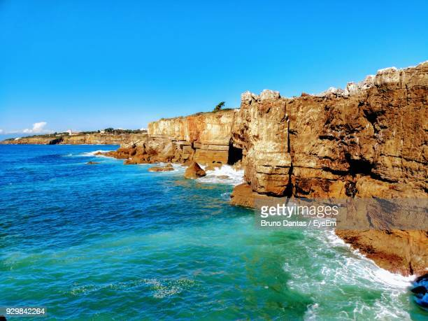rock formations in sea - cascais stock photos and pictures