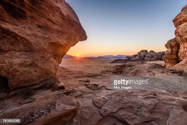 rock formations in the desert wilderness in southern jordan at sunset. - jordan stock pictures, royalty-free photos & images