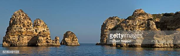 Rock formations in the sea at Lagos, Portugal, Europe