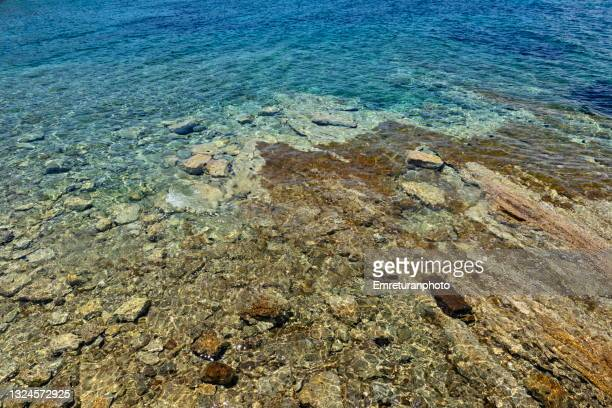 rock formations in turquise waters of aegean sea. - emreturanphoto stock pictures, royalty-free photos & images