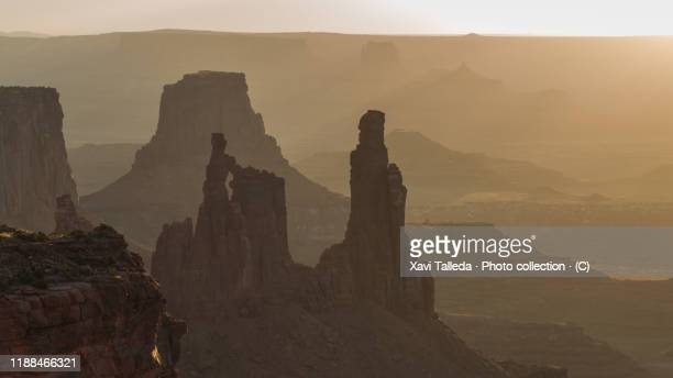 rock formations of the canyon at sunrise - utah stock pictures, royalty-free photos & images