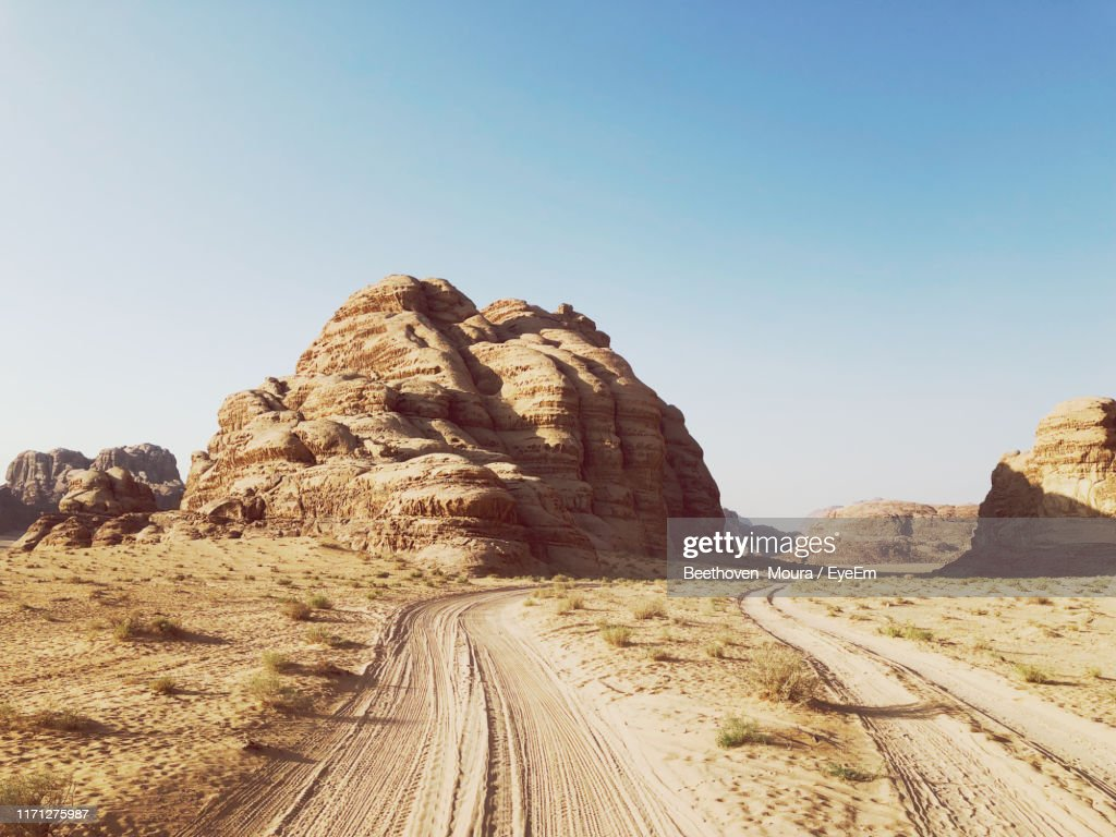 Rock Formations On Landscape Against Clear Sky : Stock Photo