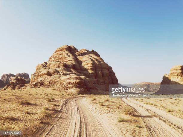 rock formations on landscape against clear sky - moura stock photos and pictures