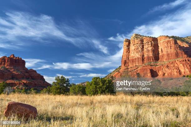 rock formations on landscape against cloudy sky - arizona stock photos and pictures