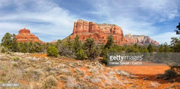 rock formations on landscape against cloudy sky - sedona stock photos and pictures