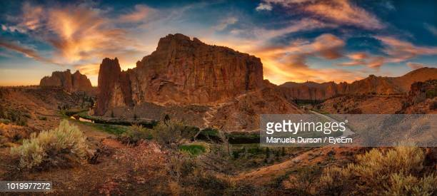 rock formations on landscape against sky during sunset - smith rock state park stock pictures, royalty-free photos & images