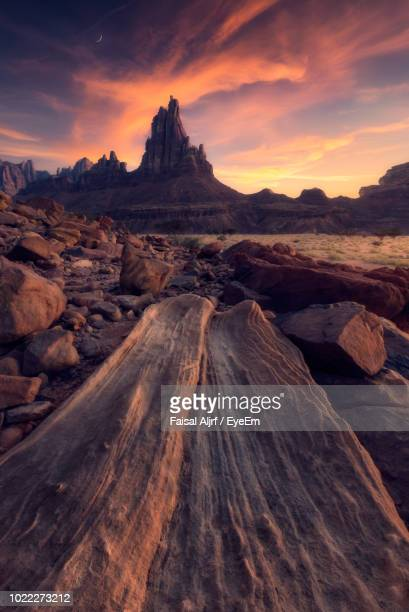 rock formations on landscape against sky during sunset - beauty in nature stock pictures, royalty-free photos & images