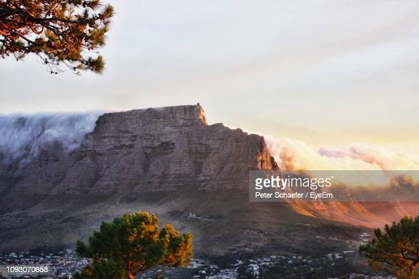rock formations on landscape against sky during sunset - table mountain stock pictures, royalty-free photos & images
