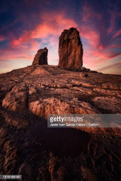 rock formations on landscape against sky during sunset - tejeda canary islands stock pictures, royalty-free photos & images