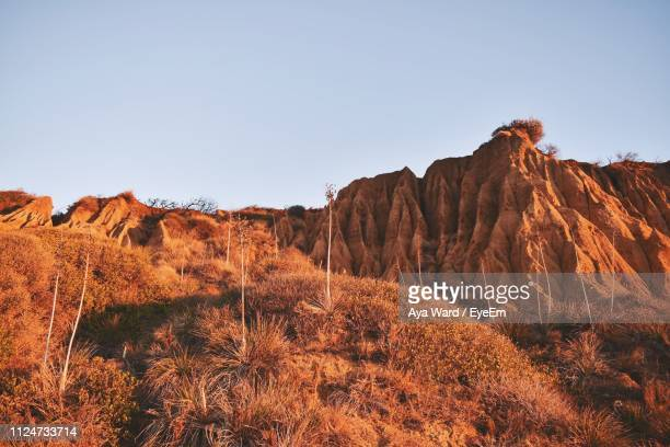rock formations on landscape against sky - malibu beach stock pictures, royalty-free photos & images