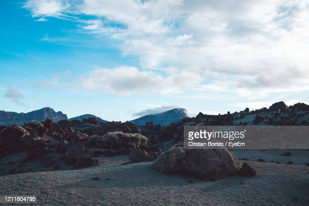 rock formations on landscape against sky - bortes stock pictures, royalty-free photos & images
