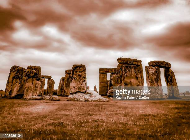 rock formations on landscape against sky - rock stock pictures, royalty-free photos & images