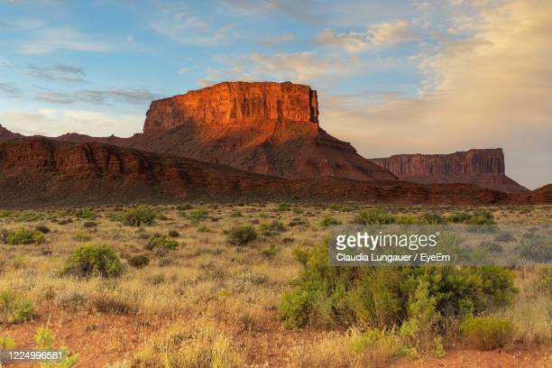 rock formations on landscape against sky - canyonlands national park stock pictures, royalty-free photos & images