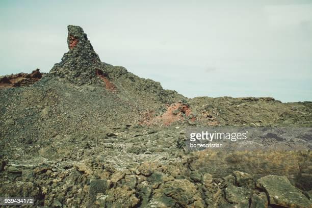 rock formations on landscape against sky - bortes fotografías e imágenes de stock