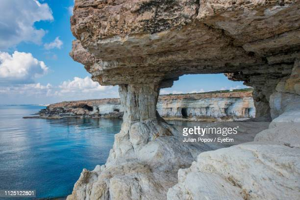 rock formations on sea shore against sky - republic of cyprus stock pictures, royalty-free photos & images