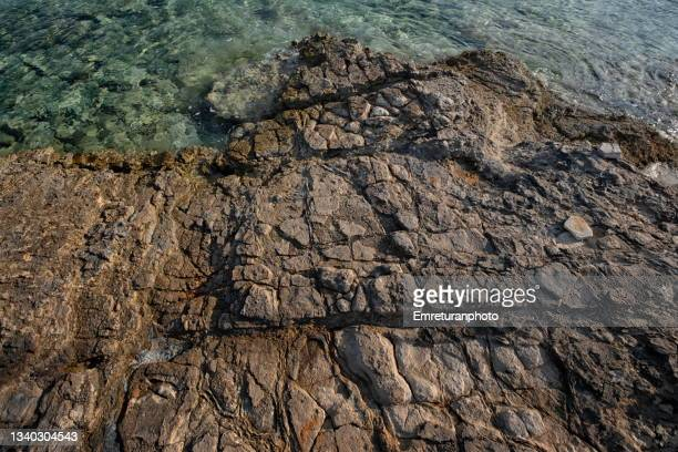 rock formations on the coastline in cesme. - emreturanphoto stock pictures, royalty-free photos & images