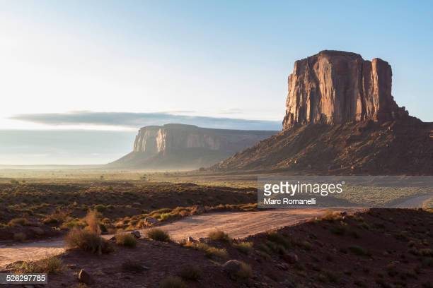 Rock formations overlooking desert landscape, Monument Valley, Utah, United States