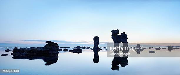 Rock formations reflecting at sea