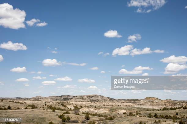 rock formations stand prominent on the grasslands of north dakota. - north dakota stock pictures, royalty-free photos & images