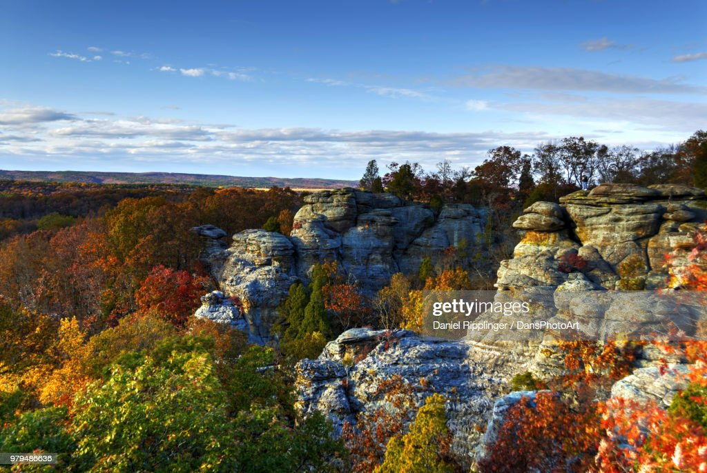 Rock formations surrounded by trees with autumnal foliage on sunny day, Illinois, USA : Stock Photo
