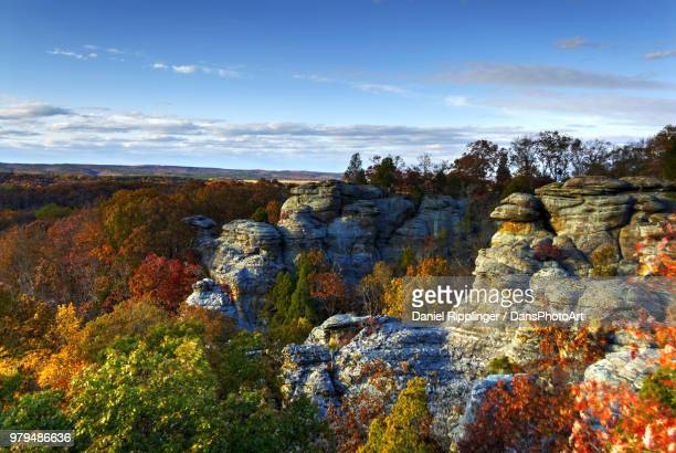 rock formations surrounded by trees with autumnal foliage on sunny day, illinois, usa - illinois stock pictures, royalty-free photos & images