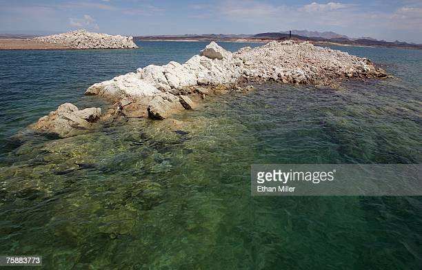 Rock formations that were underwater about two months ago jut out above the surface of Lake Mead posing a risk to boaters on July 30 2007 in the Lake...
