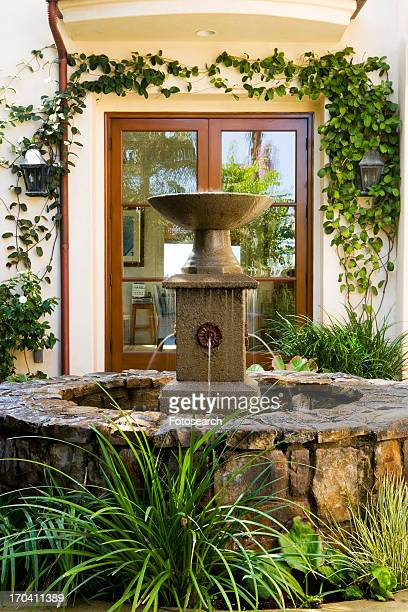 Rock Fountain in Spanish Style Courtyard