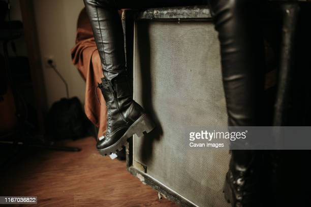 rock girl sitting on a guitar cabinet. - heavy metal stock pictures, royalty-free photos & images