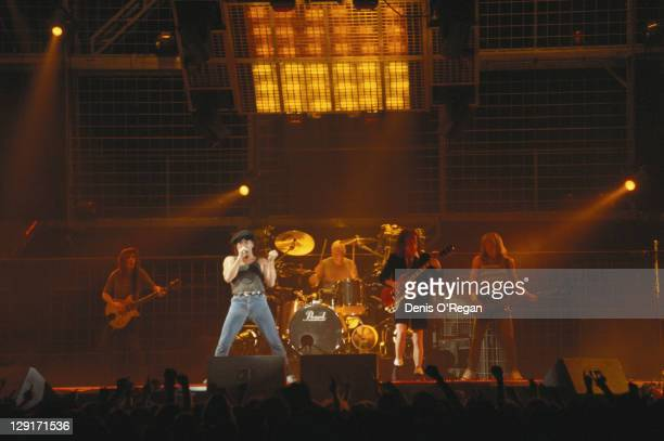 Rock group AC/DC performing on stage circa 1990 Left to right Malcolm Young Brian Johnson Chris Slade Angus Young and Cliff Williams