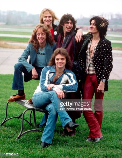 Rock group Aerosmith pose for a portrait on tarmac before boarding a Lear jet at Evansville Regional Airport, Evansville Ohio, November 6, 1977