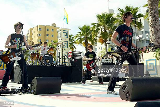Rock group AllAmerican Rejects perform during a taping for MTV Spring Break 2003 at the Surfcomber Hotel March 12 2003 in Miami Beach Florida