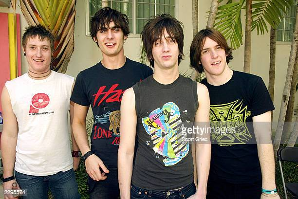 Rock group AllAmerican Rejects stand backstage during a taping for MTV Spring Break 2003 at the Surfcomber Hotel March 12 2003 in Miami Beach Florida