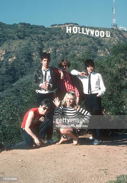 Rock group Blondie including Chris Stein Clem Burke James Destri and Nigel Harrison with Debbie Harry pose for a portrait in March 1977 on a hill...