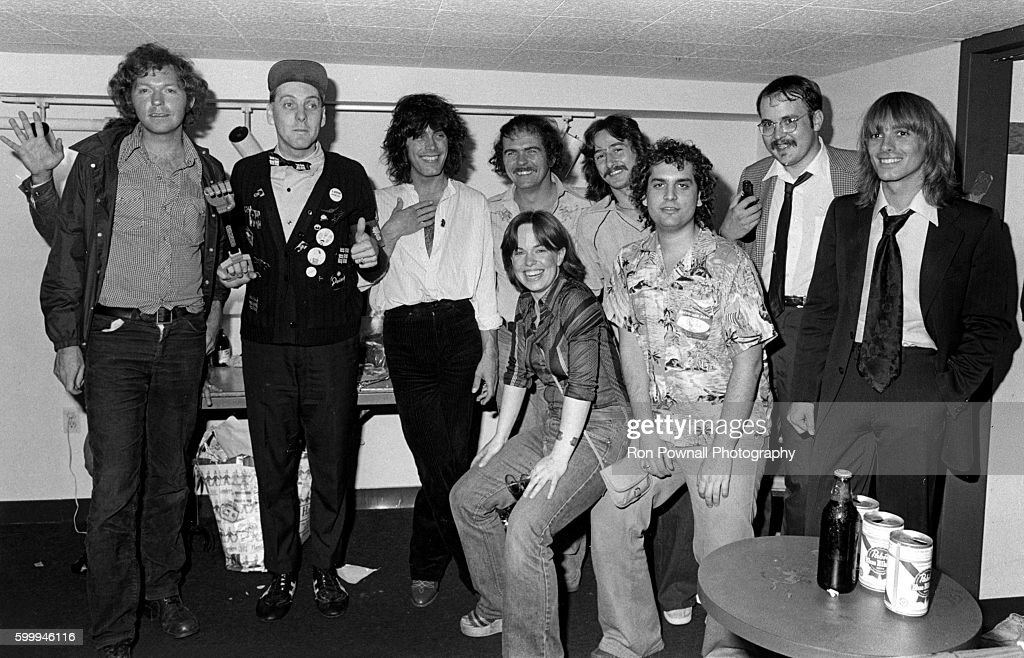 Rock group Cheap Trick backstage with Barry Goudreau (of band Boston) and others at The Paradise on June 9, 1978 in Boston, Massachusetts.