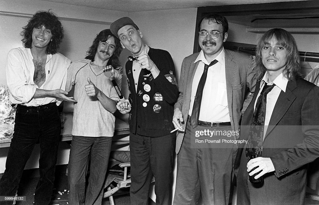 Rock group Cheap Trick backstage with Barry Goudreau (of band Boston) at The Paradise on June 9, 1978 in Boston, Massachusetts.