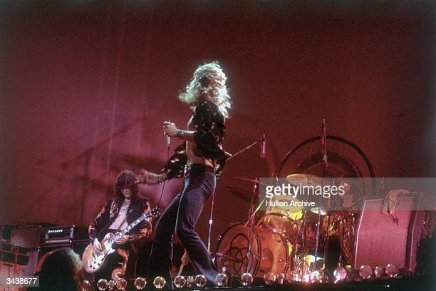 Rock group Led Zeppelin performing on stage From left to right Jimmy Page Robert Plant and John Bonham