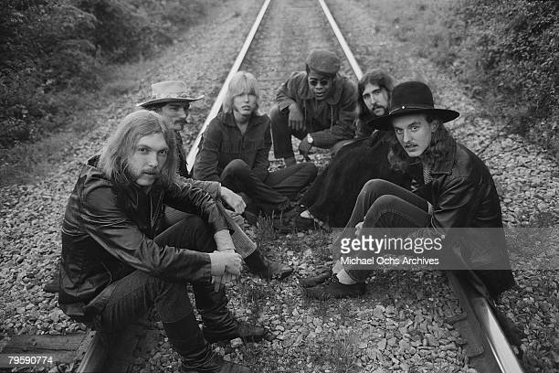 Rock group The Allman Brothers Duane Allman Dickey Betts Gregg Allman Jai Johanny Johanson Berry Oakley and Butch Trucks sit on some rairoad tracks...